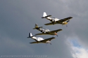 North American Aviation P-51 Mustang three-ship formation flight at Duxford Flying Legends 2007