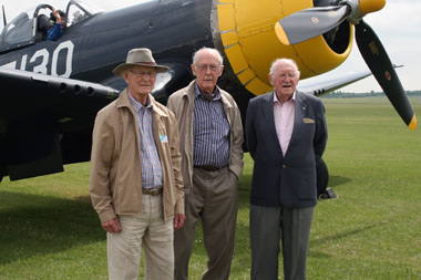 Christopher Cartledge, Keith Quilter and Peter George standing in front of a Corsair