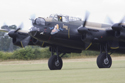 Avro Lancaster Mk VII NX611 Just Jane taxiing around the grass strip at the East Kirkby RAFBF Air Show 2010