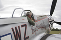 Rob Davies sitting in P-51D Mustang Big Beautiful Doll at the East Kirkby RAFBF Air Show 2010