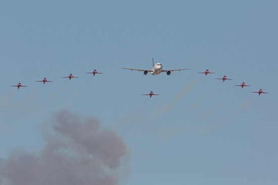 The Red Arrows flypast with a Air Malta Airbus A320 at the Malta Air Show 2014