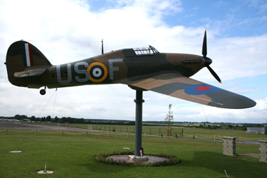 Gate guardian replica Hawker Hurricane Mk I V7313/US-F of RAF's 56 Squadron at North Weald Airfield