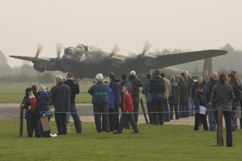 Avro Lancaster Mk VII NX611 Just Jane and crowd at the East Kirkby Just Jane Armistice Event